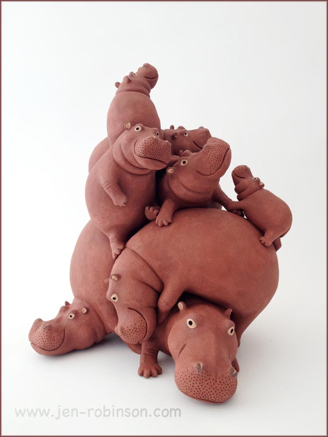 stoneware sculpture of a pile of 9 hippos