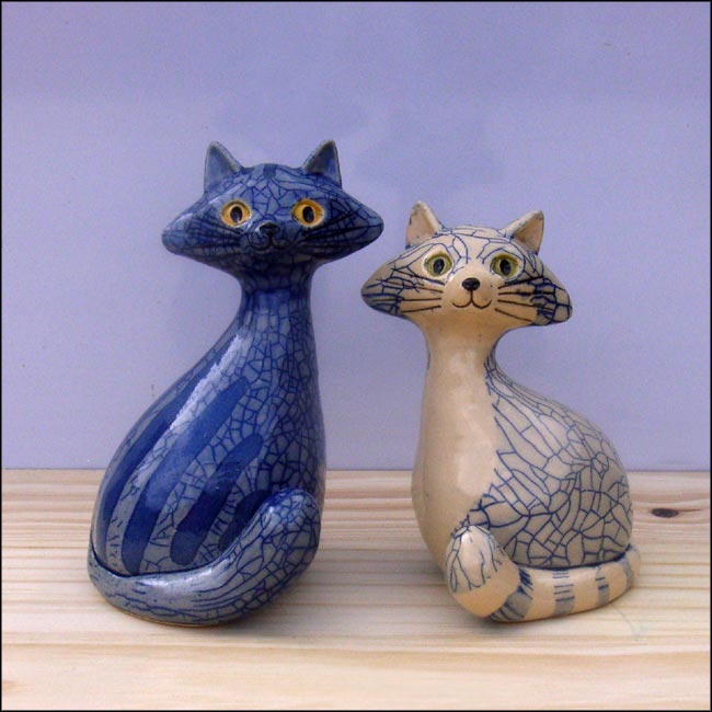 blue ceramic cat sculptures