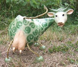green and white cow
