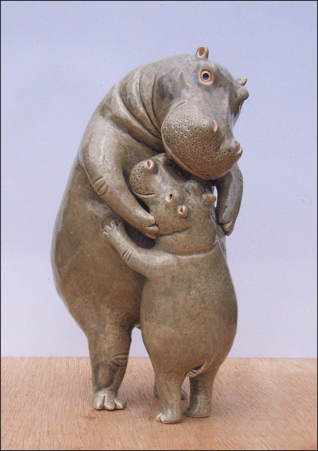 hugging hippos sculpture